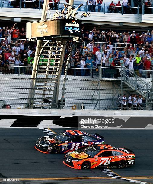 Sprint Cup Series driver Denny Hamlin beats Martin Truex Jr across the finish line to win the Daytona 500 at Daytona International Speedway in...