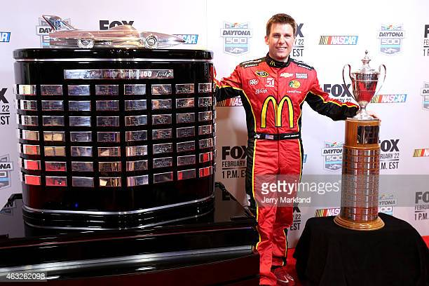 Sprint Cup Series driver Jamie McMurray poses with the Daytona 500 and Rolex 24 trophies during the 2015 NASCAR Media Day at Daytona International...