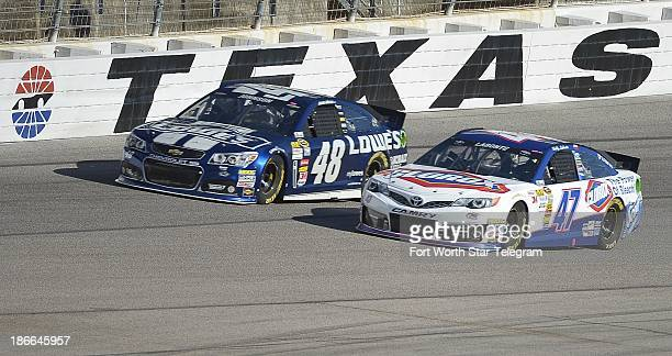 Sprint Cup Series driver Jimmie Johnson Sprint Cup Series driver Bobby Labonte practices before the O'Reilly 300 Nationwide race at Texas Motor...