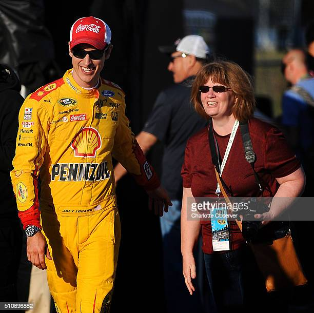 Sprint Cup Series driver Joey Logano left smiles as he poses for fans at Daytona International Speedway on Wednesday Feb 17 in Daytona Beach Fla