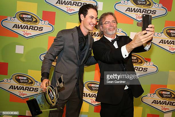 Sprint Cup Series driver Joey Logano poses with Bill Engvall during the 2015 NASCAR Sprint Cup Series Awards show at Wynn Las Vegas on December 4...