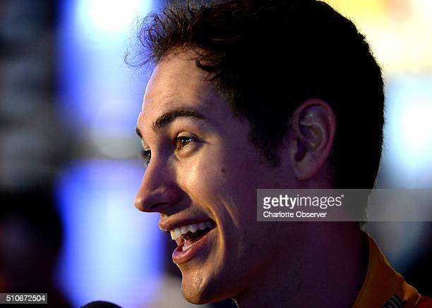 Sprint Cup Series driver Joey Logano smiles as he responds to a reporter's question during the NASCAR Media Day at Daytona International Speedway on...