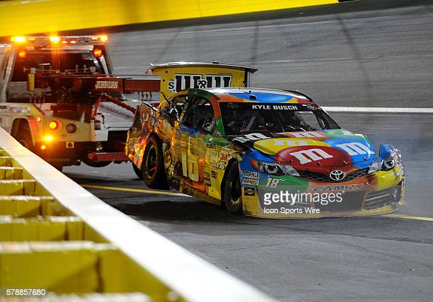 Sprint Cup Series driver Kyle Busch crashes early and his car has to be towed into the garage in the Sprint allStar race at Charlotte Motor Speedway...