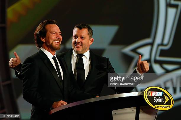 Sprint Cup Series driver Tony Stewart and musician Eddie Vedder speak during the 2016 NASCAR Sprint Cup Series Awards show at Wynn Las Vegas on...