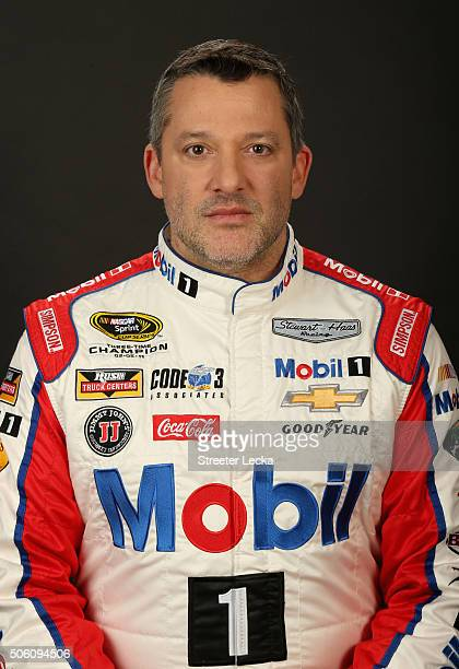 Sprint Cup Series driver Tony Stewart poses for a portrait during day 3 of the 2016 Charlotte Motor Speedway Media Tour at NASCAR Hall of Fame on...