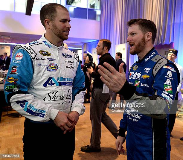 Sprint Cup Series drivers Brian Scott left and Dale Earnhardt Jr right talk during the NASCAR Media Day at Daytona International Speedway on Tuesday...