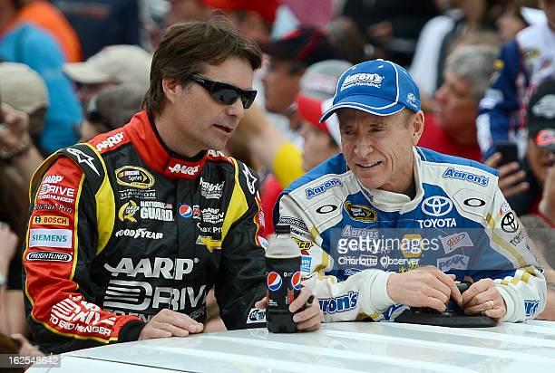 Sprint Cup Series drivers Jeff Gordon left and Mark Martin talk following driver introductions prior to the Daytona 500 at Daytona International...