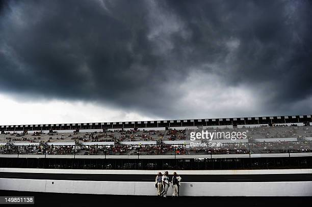 Sprint Cup Series Officials stand on pit road before the start of the NASCAR Sprint Cup Series Pennsylvania 400 at Pocono Raceway on August 5 2012 in...