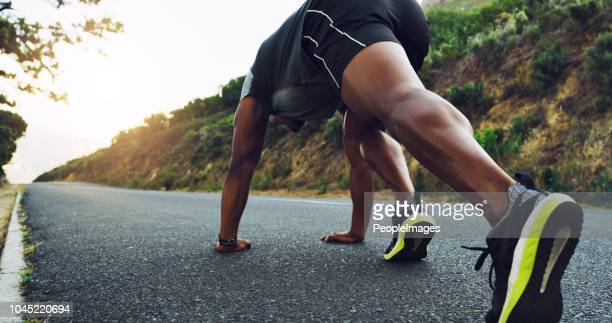 sprint towards the lifestyle you want - men's track stock pictures, royalty-free photos & images