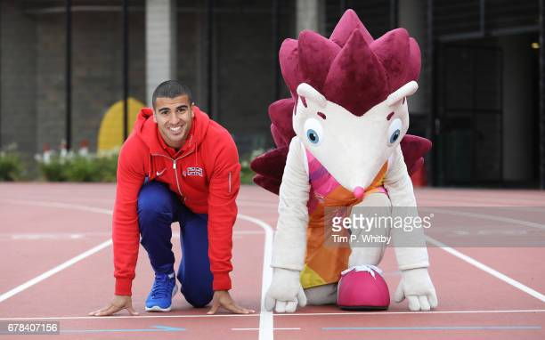 Sprinter Adam Gemili of Great Britain poses with IAAF World Championships London 2017 Mascot Hero the Hedgehog during a photo shoot at The London...