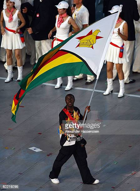 Sprinter Brian Dzingai of Zimbabwe carries his nation's flag during the Opening Ceremony for the 2008 Beijing Summer Olympics at the National Stadium...