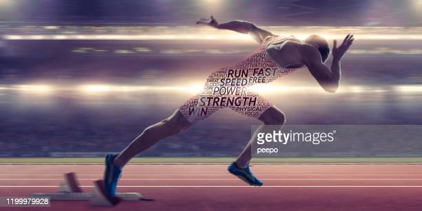 sprinter bursting from starting blocks with motivational word cloud body - sprint stock pictures, royalty-free photos & images