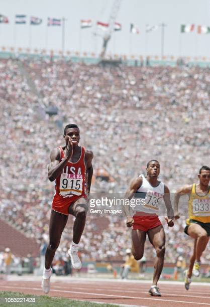 Sprinter Carl Lewis in action during the Mens 100 Metres Heats with Peter Van Miltenburg of Australia at the Los Angeles Memorial Coliseum on August...