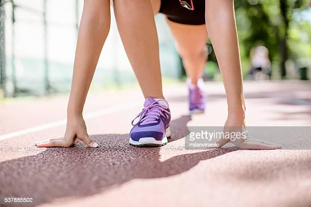 Sprinter girl getting ready for the run