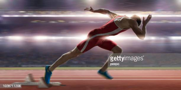 sprinter high speed burst from blocks at stadium athletics event - sprinting stock pictures, royalty-free photos & images