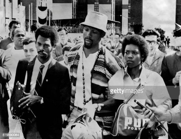 US sprinter John Carlos leaves the Olympic village with his wife after being suspended along with his teammate Tommie Smith from his national team...