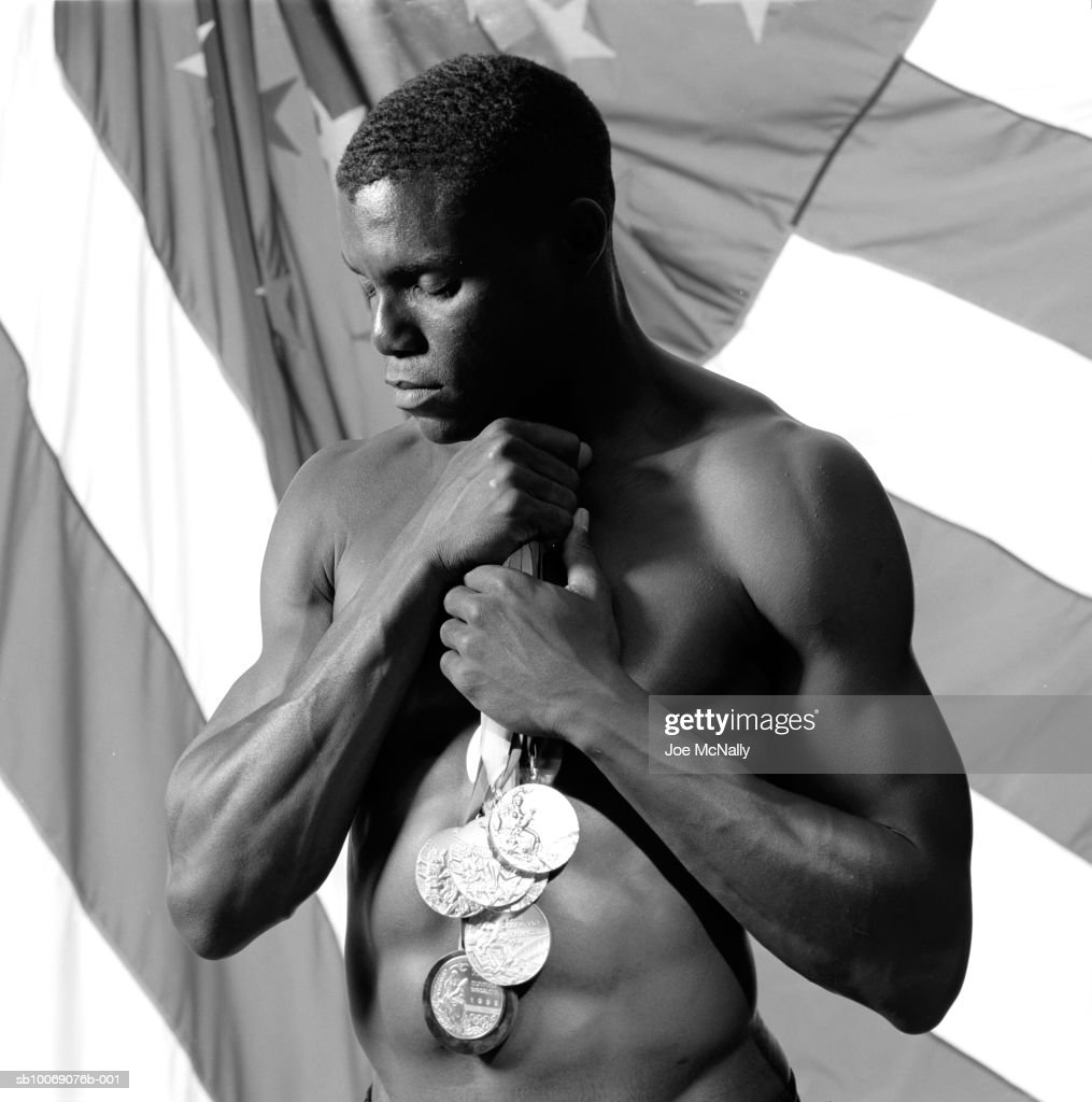 Sprinter, long jumper, and eight-time gold medalist, Carl Lewis, poses naked showing off his toned physique in June of 1996 in a training facility in Atlanta, Georgia. The olympians of ancient greece trained not only to compete but to attain physical abilities that rivaled those of the common man--with the feats achieved during the present day olympics its fair to say little has changed. These athletes train their bodies to machine-like capabilities in order to beat the competition by sometimes only a hundredth of a second. Some have done it with severe heat stroke or even a broken leg.
