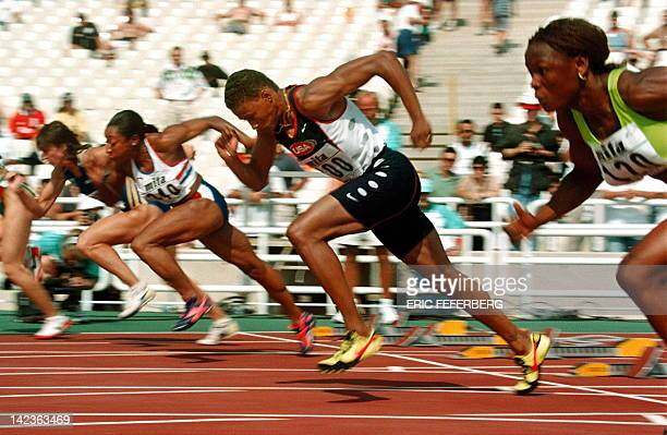 Sprinter Marion Jones gets off for a powerful start of her 100m heat at the Athens '97 World Championships in Athens 02 August. Jones won her heat...