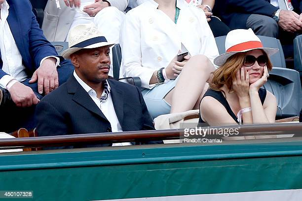 Sprinter Maurice Green and actress Marine Delterme attend the Roland Garros French Tennis Open 2014 - Day 12 on June 5, 2014 in Paris, France.