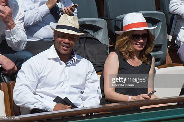 Sprinter Maurice Green and actress Marine Delterme attend the Roland Garros French Tennis Open 2014 - Day 12 at Roland Garros on June 5, 2014 in...