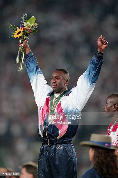 US sprinter Michael Johnson earns a gold medal for an Olympic recordsetting 400 meter run of 4349 seconds during Atlanta's 1996 Olympic Games