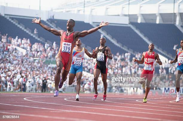 Sprinter Michael Johnson raises his arms in triumph after breaking the world record in the men's 200meter sprint at the 1996 Olympic Trials in Atlanta
