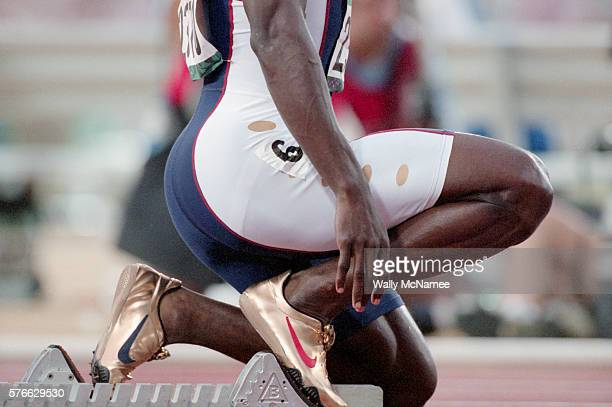 US sprinter Michael Johnson wears his gold shoes as he prepares for the start of his 400 meter heat at Atlanta's Olympic Stadium during the 1996...