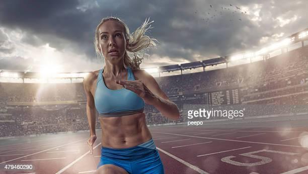 Sprinter Running On Athletics Track