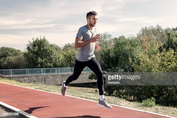 sprinter running on runners tracks - sprinting stock pictures, royalty-free photos & images