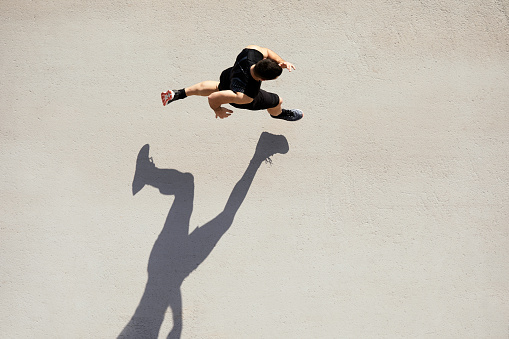 Sprinter seen from above with shadow and copy space. 1139036071