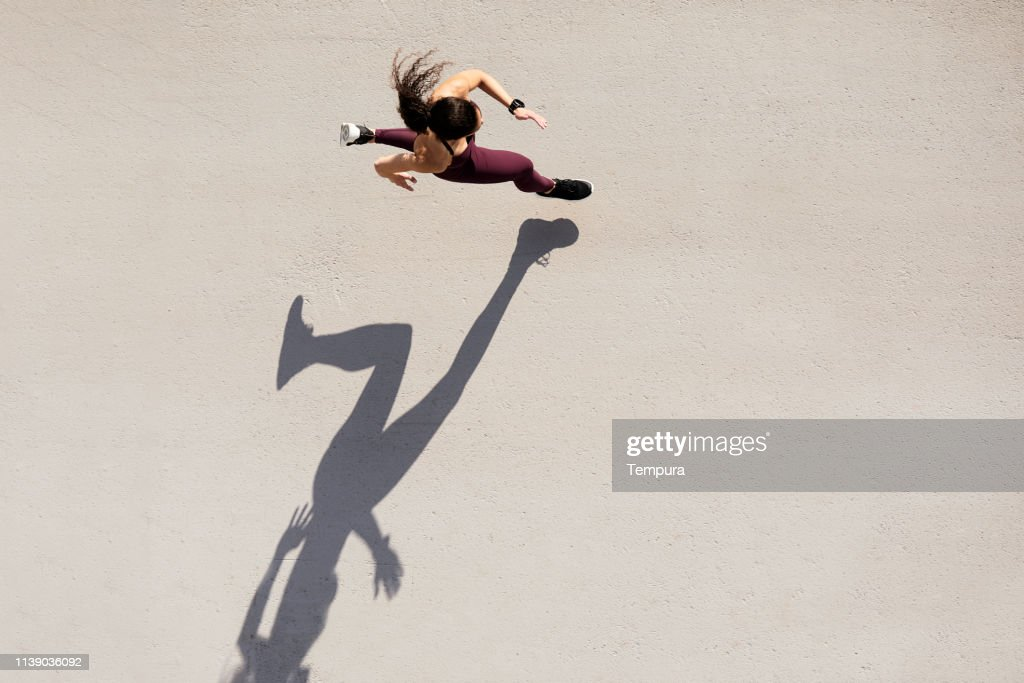 Sprinter seen from above with shadow and copy space. : Stock Photo