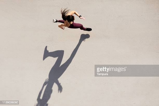 sprinter seen from above with shadow and copy space. - atleta imagens e fotografias de stock
