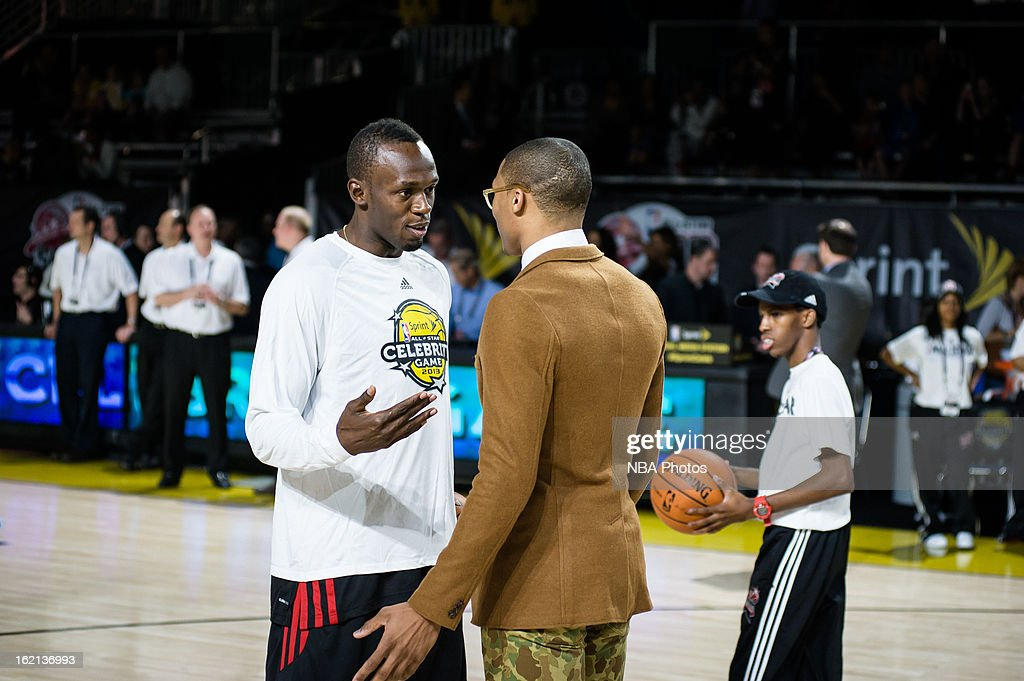 Sprinter Usain Bolt and Russell Westbrook of the Oklahoma City Thunder talk during the Sprint NBA All-Star Celebrity Game in Sprint Arena at Jam Session during the NBA All-Star Weekend on February 15, 2013 at the George R. Brown Convention Center in Houston, Texas.