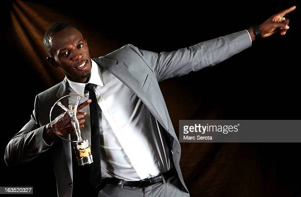 Sprinter Usain Bolt of Jamaica poses with the award for Laureus World Sportsman of the Year in the winners studio during the 2013 Laureus World...