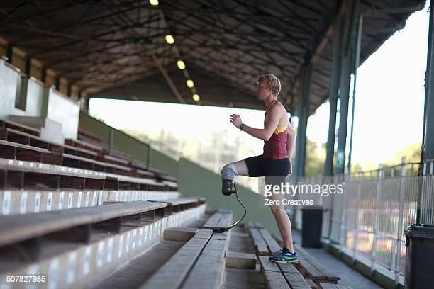 Sprinter walking with prosthetic leg on