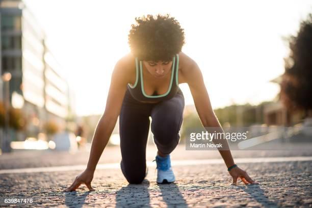 Sprinter woman at start position, Ready to run.