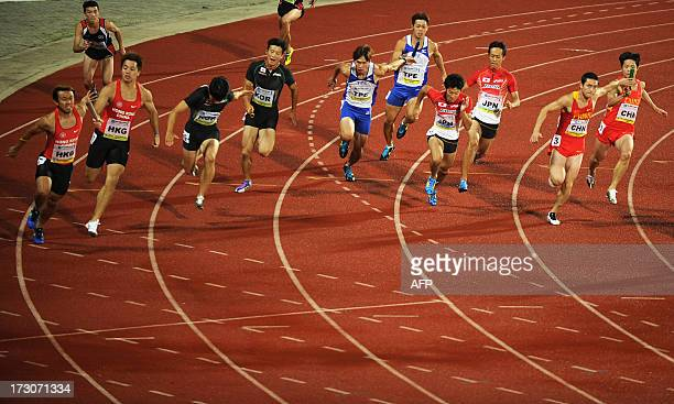Sprinters hand over batons during the men's 4 x 100 metres relay on the fourth day of the fiveday Asian Athletics Championship 2013 at the Chatrapati...