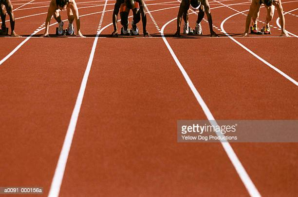 sprinters in starting blocks - beginnings stock pictures, royalty-free photos & images