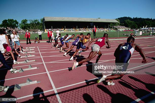Sprinters Leaping From the Starting Blocks