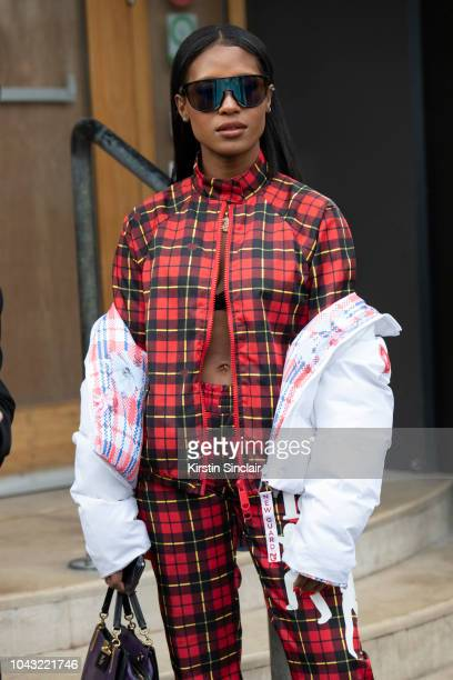 S/Producer Angel and Dren wears Nicopanda tracksuits during London Fashion Week September 2018 on September 14, 2018 in London, England.