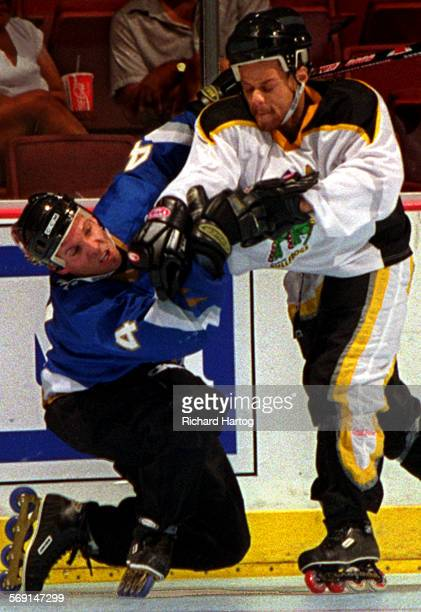 SPRoller HockeyRH––062898––Anaheim Bullfrog Taj Melson right lands a right hook to the jaw of Tampa Bay's Eric Lemarque left as the two scuffle...