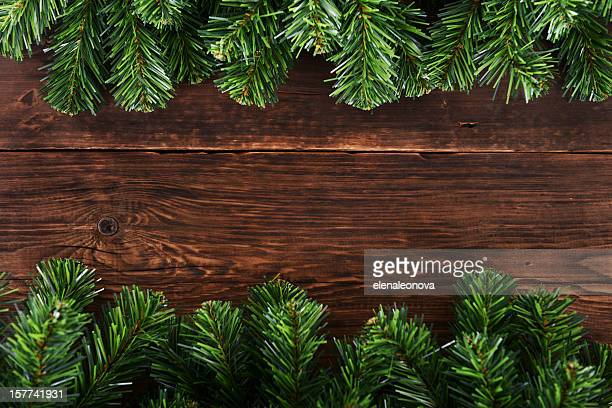 Spruce branches lining a dark wooden table