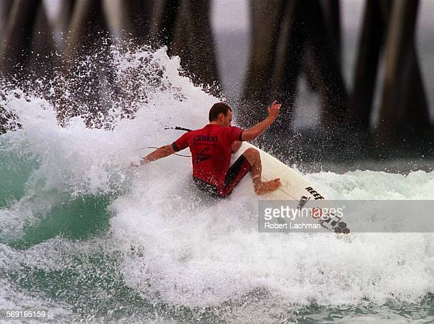 SPSurfMalloyRDL–– Keith Malloy rides a wave during his heat at the G–Shock US Open next to the Huntington Beach Pier in Huntington Beach TIMES