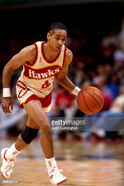 Spud Webb of the Atlanta Hawks brings the ball upcourt against the Denver Nuggets during an NBA game at the Omni circa 1986 in Atlanta Georgia NOTE...