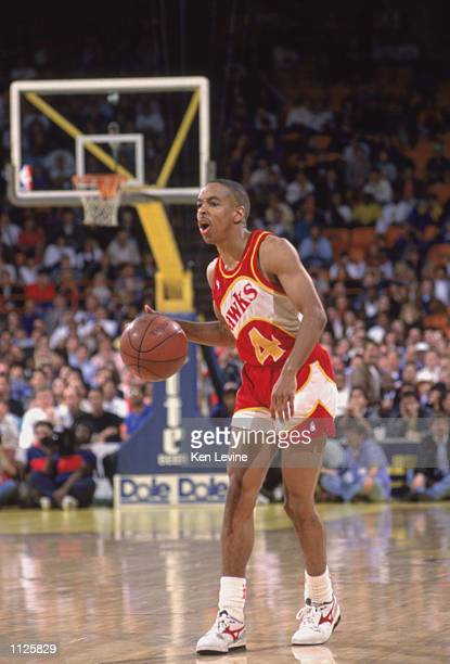 Spud Webb of the Atlanta Hawks dribbles the ball during a NBA game against the Los Angeles Lakers at the Great Western Forum in Inglewood California...