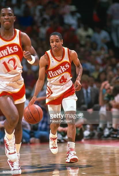 Spud Webb of the Atlanta Hawks dribbles the ball up court during an NBA basketball game circa 1986 at the Omni Coliseum in Atlanta Georgia Webb...