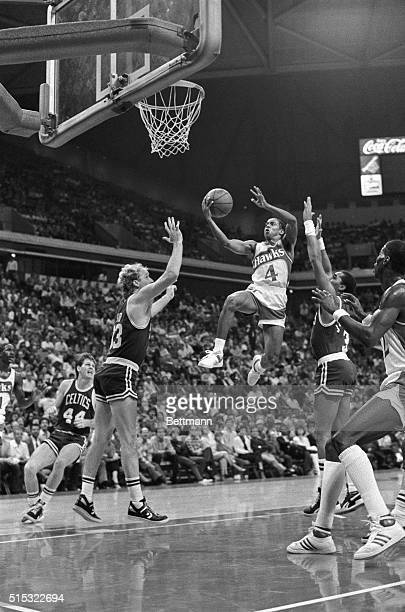 Spud Webb, the 5-foot 7-inch guard for the Atlanta Hawks, flies past Celtic defenders Larry Bird and Dennis Johnson on his way to two points during...