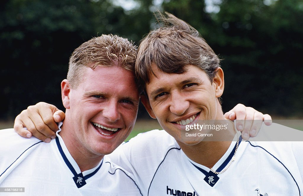 Spurs and England team mates Paul Gascoigne (l) and Gary Lineker share a joke at a Tottenham Hotspur pre season photocall prior to the 1990/91 season in London, England.