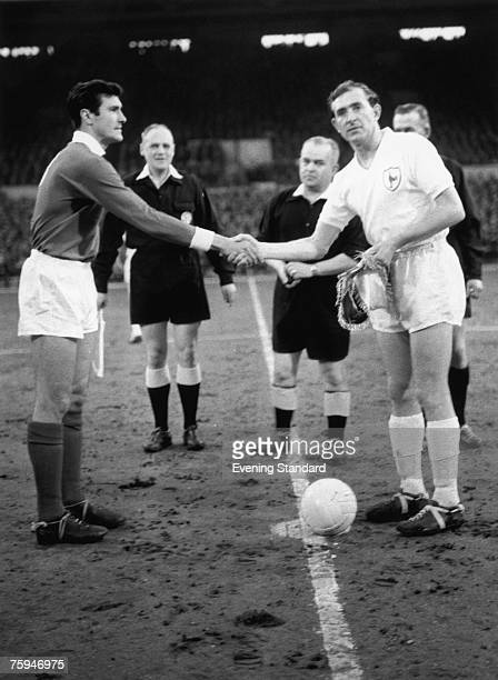 Spurs captain Danny Blanchflower shaking hands with Benfica captain Jose Aguas before the second leg of the European Cup semi final at White Hart...