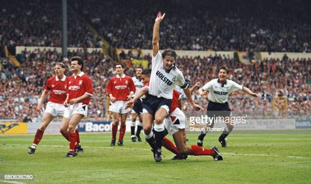 Spurs captain Gary Mabbutt and Gary Lineker celebrate as Forest defender Des Walker scores an own goal to give Tottenham a 21 lead as Forest players...
